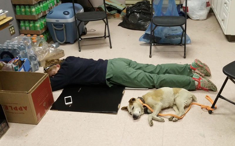 Volunteers take the opportunity to rest whenever and wherever they can.